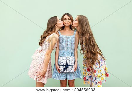 Two Beautiful Girls Kiss Her Beautiful Young Adult Friends, Congratulations With Birthday And Give A