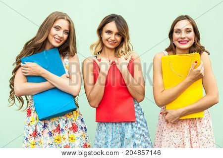 Close Up. Young Adult Girl In Dress, Hug Her Colorful Bags