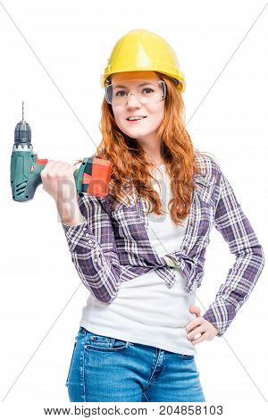 Slim Beautiful Woman With A Drill In Protective Clothing Ready To Work