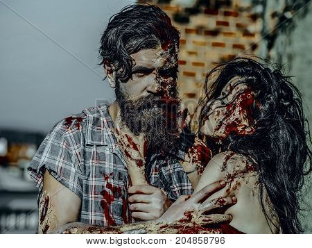 Halloween Vampire With Beard And Red Blood Wounds Outdoors