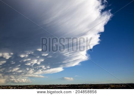 Massive Storm Cloud Towering over grouping of Homes