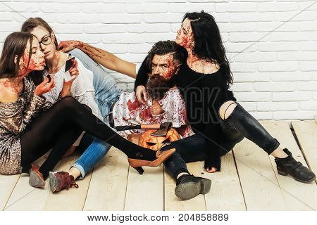 Halloween Zombie People Of Bearded Man And Bloody Women