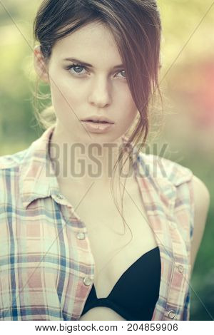 Woman In Black Bra Under Plaid Shirt.