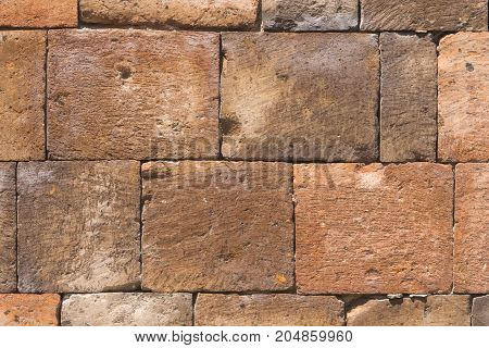 Bricks from old pink tuff in wall texture macro selective focus shallow DOF.