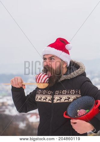 Guy With Open Mouth In Red Santa Hat And Coat