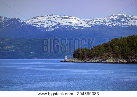 lighthouse on a fjord shore at the norway