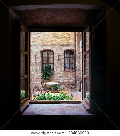 View of the Italian courtyard through the window italy