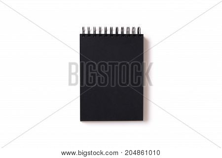 Vertical aligned isolated notebook mock up with blank black sheets on white background. Top view flat lay.
