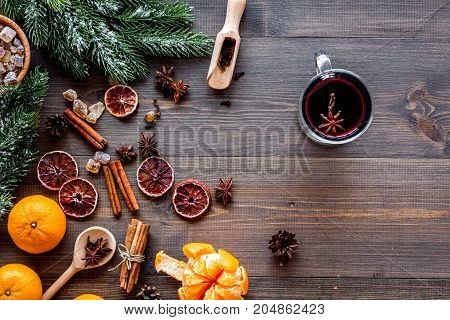 Celebrate new year winter evening with hot drink. Mulled wine or grog ingredients. Wooden desk background top view. Space for text