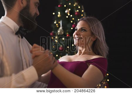 Beautiful young couple in love hugging and dancing a midnight waltz