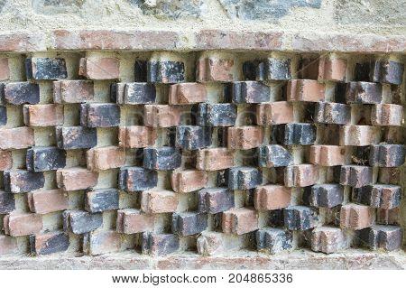 Ornamental pattern on an old brick wall