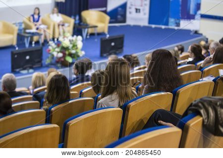 Two Hosts Giving a Talk at Business Conference in Congress Hall. Concepts of Business and Entrepreneurship.Horizontal Image