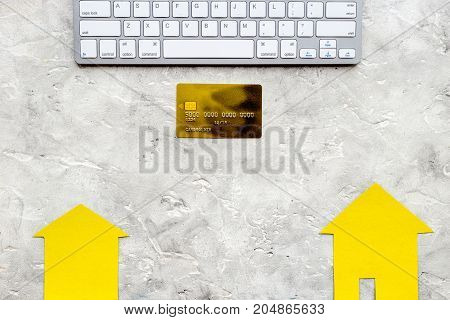 buy house online set with paper figures and credit card on office desk gray stone background top view mock-up