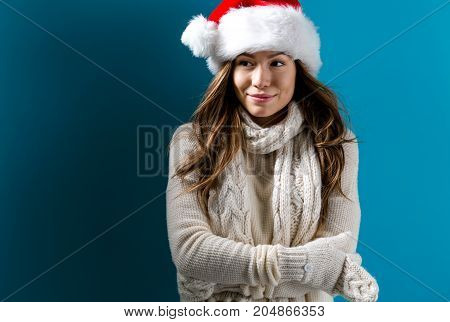 Happy young woman in winter clothes in night