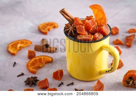candied pumpkinin cup with spicies and oranges