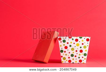 Big present box on a red background