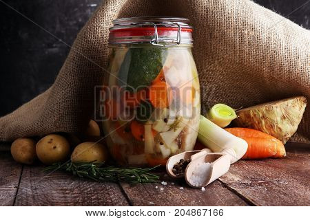 Jar With Variety Of Pickled Vegetables. Broth, Carrots, Field Garlic, Parsley In Glas. Preserved Foo