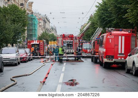 Saint Petersburg, Russia, on the morning of September 13, 2017. Firefighters extinguish a large fire on the roof of a residential house on the street Tchaikovsky 31.