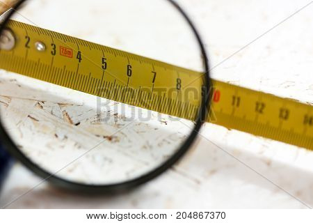 Yellow Measuring Tape Under Magnifying Glass
