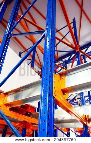 Warehouse racks metal dismountable constructions modern warehouse technology background concept vertical orientation close-up with perspective view from the bottom to top