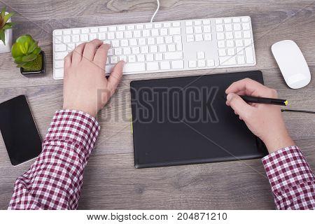 The Graphic Designer Uses A Digital  Pen  Tablet