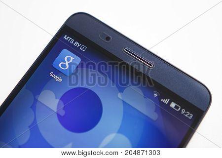 Minsk Belarus - September 17 2017: Google app icon on modern smartphone display close-up on white background.