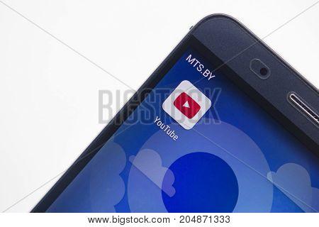 Minsk Belarus - September 17 2017: YouTube app icon on modern smartphone display close-up on white background