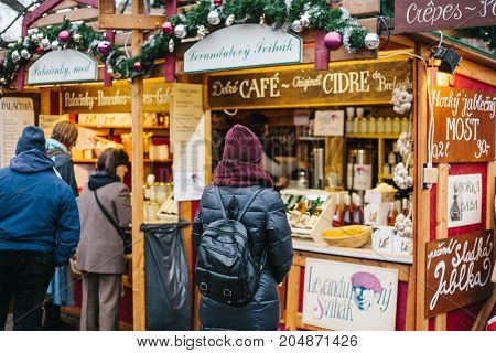 Prague, December 15, 2016: The tourist looks at the goods in the traditional Christmas market. Celebrating Christmas. Christmas shopping.