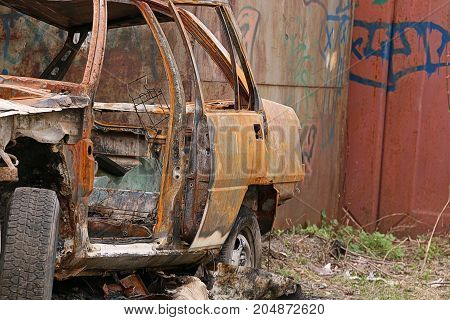 Car burned after protests. Crime. Burned stolen car.