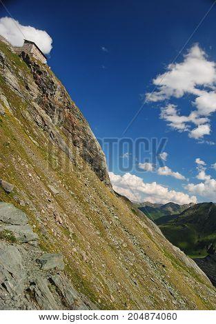 Mountain hut at Kaiser-Franz-Joseph-Hohe peak in Austrian Alps.