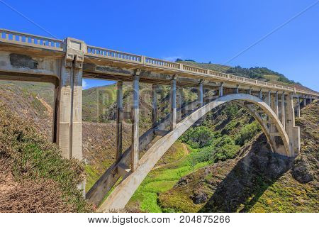Scenic view of iconic Bixby Bridge on Pacific Coast Highway Number 1 in California, United States. Bixby Bridge is most photographed and popular bridge located in Big Sur. American travel concept
