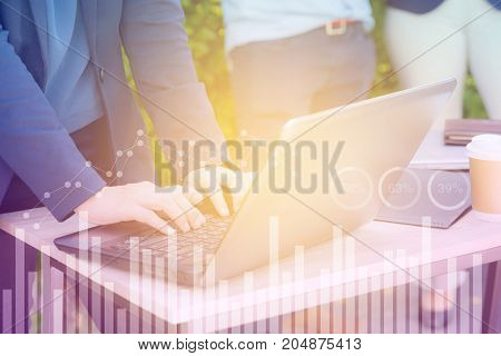 Business economic and technology working concept. Woman hand using notebook double exposure graph money stock trading finance concept.