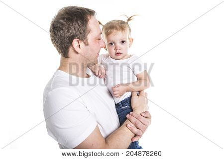 A loving father holding baby boy isolated on white