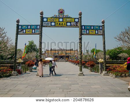 Hue, Vietnam - September 13 2017: Unidentified people walking at the enter of an arch in Imperial City Hue Vietnam.