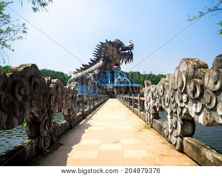 Hue, Vietnam - September 13 2017: Huge dragon in aquarium building in abandoned water park in Hue, Vietnam. Dragon structu.