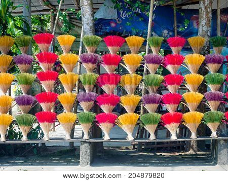 Close up of colorful incense sticks in Hue Vietnam for Buddhist monastery in Hue, Vietnam.