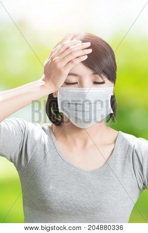 woman feel headache on the green background