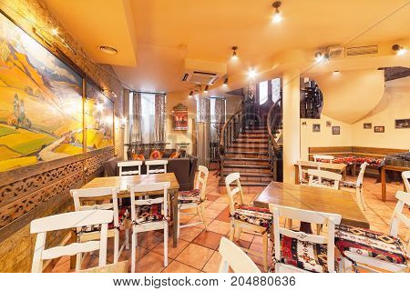 MOSCOW - AUGUST 2014: The restaurant's interior is home to the Armenian and Caucasian cuisine - Gayanes. Room with wooden furniture and a spiral staircase