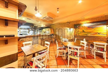MOSCOW - AUGUST 2014: The restaurant's interior is home to the Armenian and Caucasian cuisine - Gayanes. Room with wooden furniture and an open kitchen