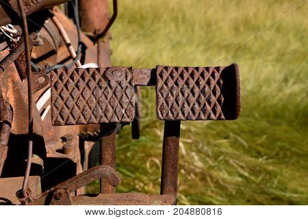 Rusty foot brake pedals of a tractor from the 1940's.
