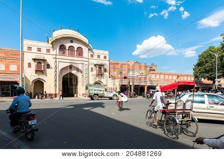JAIPUR RAJASTHAN INDIA - MARCH 11 2016: Horizontal picture of rickshaw motorcycle in front of the Gate of Bazar in Jaipur known as pink city of Rajasthan in India.