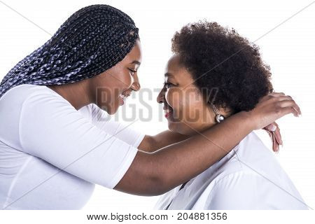 A mother and her teenage daughter isolated on white
