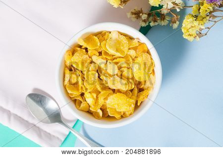 Corn flakes in a bowl with spoon for eating in the morning,breakfast or meal