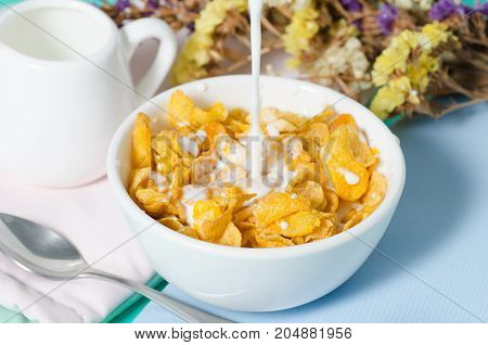 Corn flakes in a bowl with fresh milk for eating in the morning,breakfast or meal