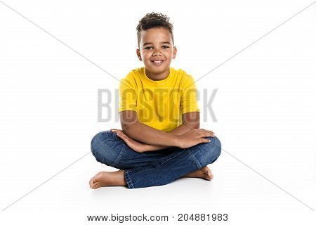 An Adorable african boy on studio white background