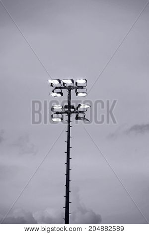 Luminous stadium floodlights or headlights to illuminate a football stadium.