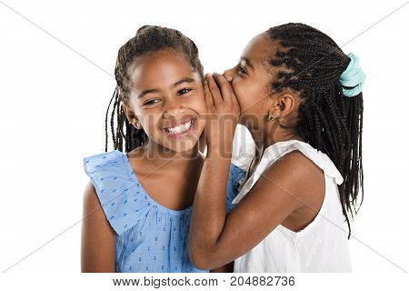 Adorable african twin girl on studio white background