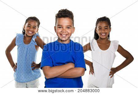A portrait of happy three black childrens, white background