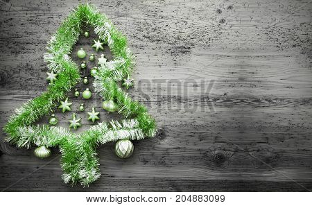 Green Tinsel Christmas Tree.Christmas Ball Ornament On Gray Wooden Background. Copy Space For Advertisement.