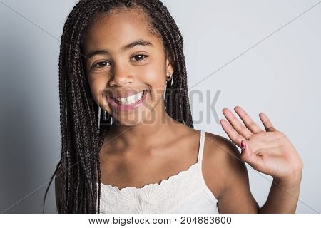 An Adorable african little girl on studio gray background